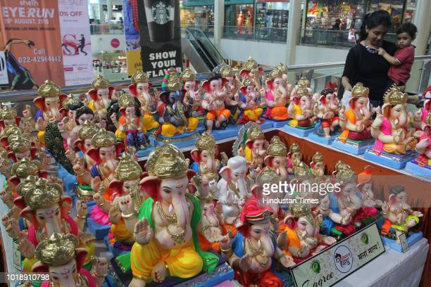 Ecofriendly Ganesha idols made of paper or clay on August 16 2018 in Thane India With ban on Plastic and Thermocol and growing awareness is leading...