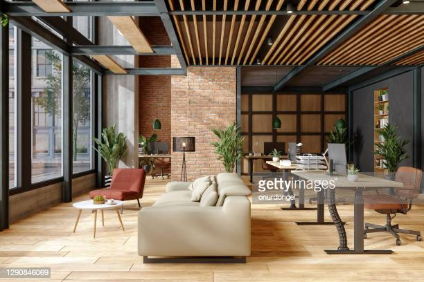 eco-friendly modern office interior with brick wall, waiting area and indoor plants. - modern stock pictures, royalty-free photos & images