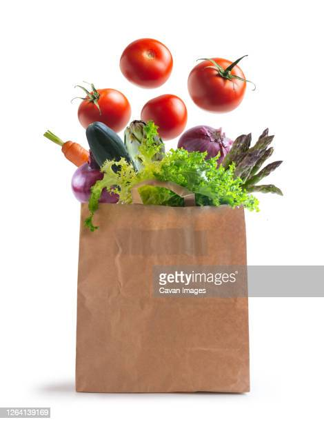 ecological bag of vegetables isolated from the background - bag stock pictures, royalty-free photos & images