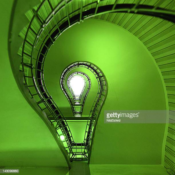 ecological light bulb near staircase - ecosystem stock pictures, royalty-free photos & images