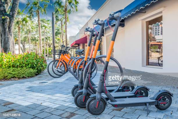 ecological movements - mobility scooter stock photos and pictures