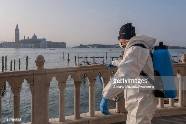 Ecological operator sanitizes the Ponte della Paglia against the corona virus on March 11 2020 in Venice Italy The Italian Government has taken the...
