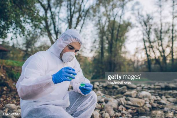 ecological water sampling - epidemic stock pictures, royalty-free photos & images