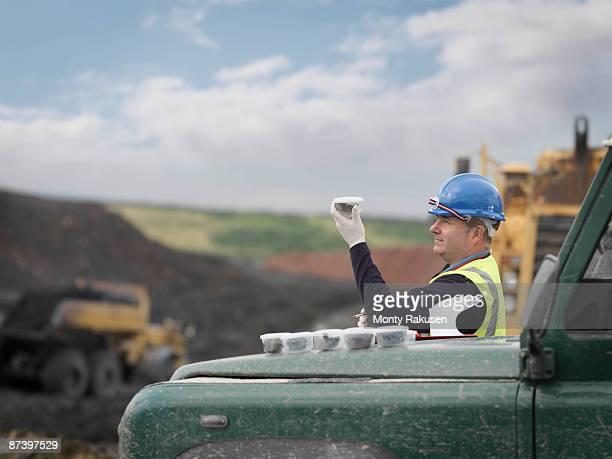 Ecologist Inspecting Soil Samples