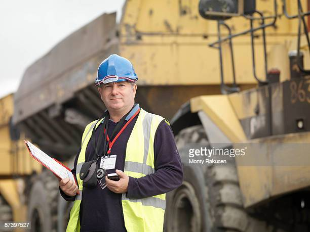 Ecologist With Heavy Machinery