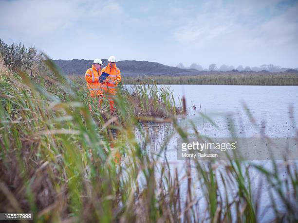 ecologists at surface coal mine restoration inspecting lake - ecologist stock pictures, royalty-free photos & images