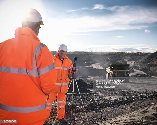 ecologists monitoring sound in surface coal mine - monty rakusen stock pictures, royalty-free photos & images