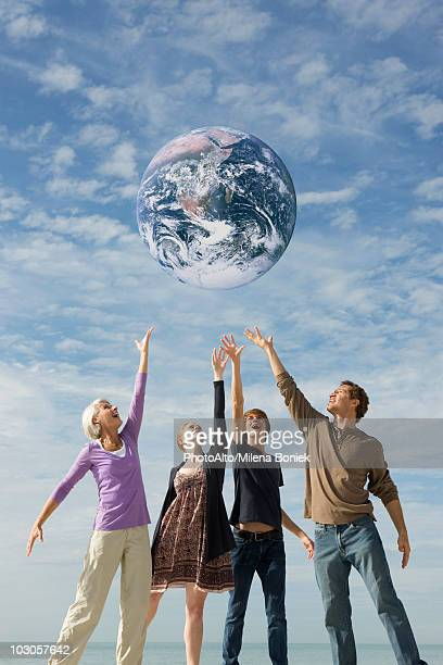 Ecology concept, group of people saving the earth together