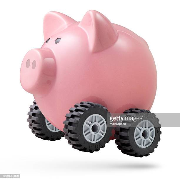 Economic acceleration. Piggy bank on wheels.