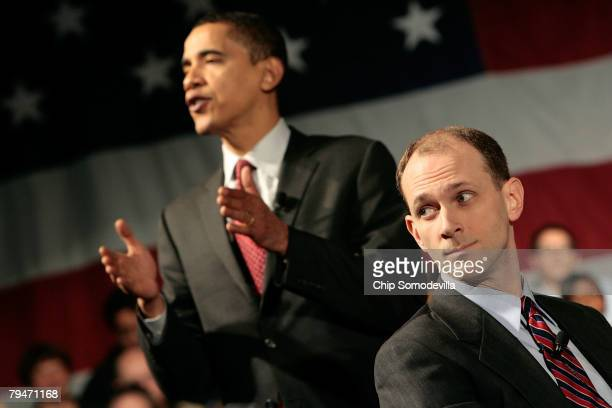 Economic advisor Austan Goolsbee listens as Democratic presidential hopeful Sen Barack Obama answers questions from audience members during a...