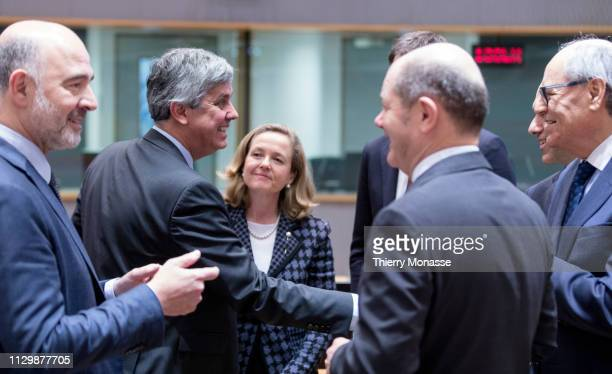 Economic and Financial Affairs, Taxation and Customs Commissioner Pierre Moscovici is talking with the Portuguese Finance Minister, President of the...