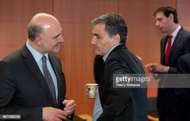 Economic and Financial Affairs Taxation and Customs Commissioner Pierre Moscovici is talking with the Greek Finance Minister Euclid Tsakalotos and...