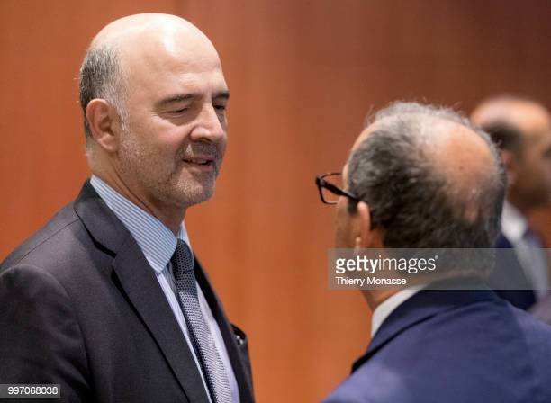 Economic and Financial Affairs Taxation and Customs Commissioner Pierre Moscovici shakes hands with the Italian Minister Economy Finance Giovanni...