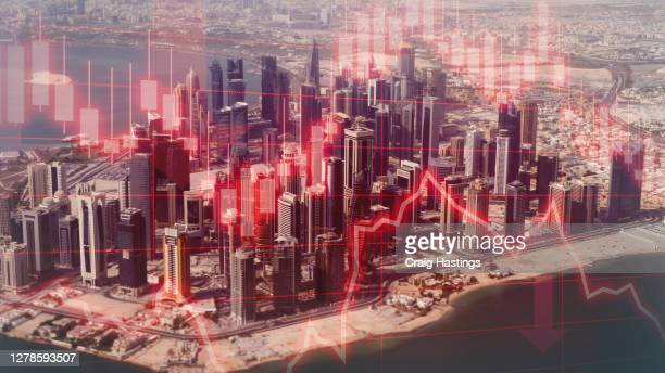 economic and financial crisis has hit qatars economy hard due to the coronavirus covid19 epidemic. world economies are edging towards recession and full depression as prices and performance crashes - qatar stock pictures, royalty-free photos & images