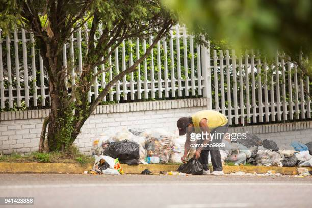 economic crisis in venezuela leads people searching for food on streets - venezuela stock pictures, royalty-free photos & images