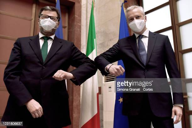 Economic Development Minister Giancarlo Giorgetti and French Minister of Economy, Finance and Relaunch Bruno Le Maire greet each other during the...