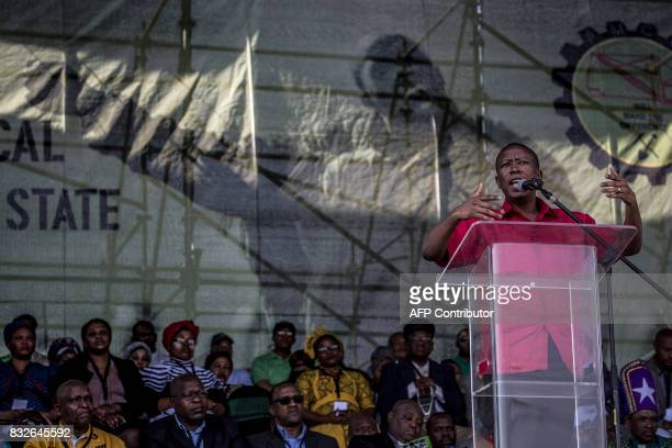 Economic Freedom Fighters leader Julius Malema addresses the crowd as members of the Association of Mineworkers and the Marikana community gather to...