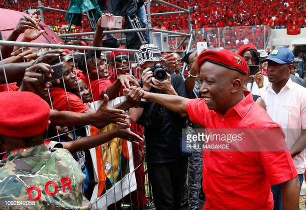 Economic Freedom Fighters leader Julius Malema greets his supporters as he arrives for the party's 2019 Election Manifesto Launch at the Giant...
