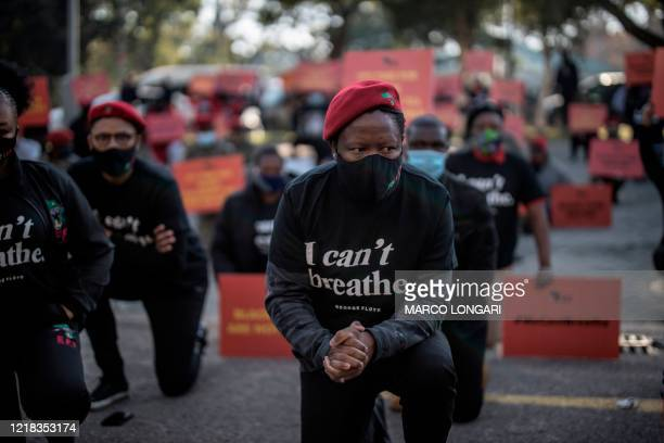 Economic Freedom Fighters leader Julius Malema kneels in front of the United States Embassy in Pretoria, on June 8, 2020. - The EFF gathered in front...