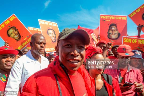 Economic Freedom Fighters party leader Julius Malema walks away after casting his vote at a polling station in the Sheshego township on the outskirts...