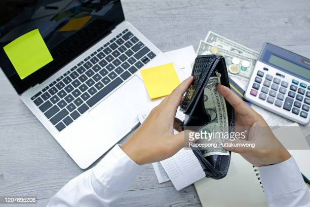 economic problem finance. hand open empty purse looking for money - unemployment stock pictures, royalty-free photos & images