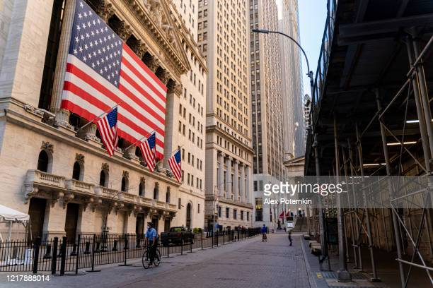 economic recession is coming. 'fearless girl' statue in front of the stock exchange from the wall street deserted because of the covid-19 pandemic. - alex potemkin coronavirus stock pictures, royalty-free photos & images