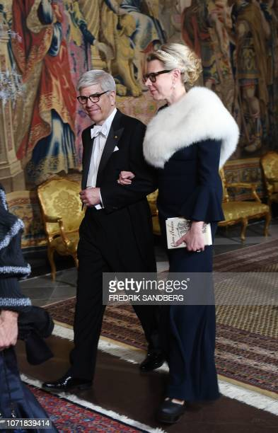 Economic Sciences laureate Paul M Romer and his wife Professor Caroline Weber arrive for the King's dinner for the Nobel Laureates at the Royal...