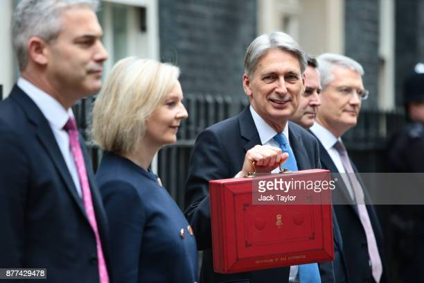 Economic Secretary to the Treasury Stephen Barclay Chief Secretary to the Treasury Elizabeth Truss stands with Britain's Chancellor of the Exchequer...