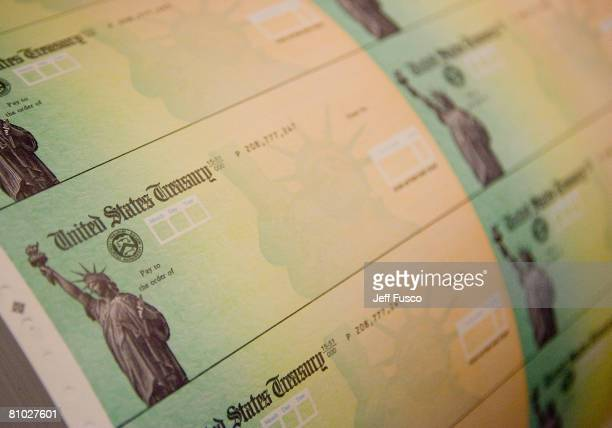 Economic stimulus checks are prepared for printing at the Philadelphia Financial Center May 8, 2008 in Philadelphia, Pennsylvania. One hundred and...