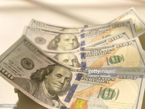 economic stimulus: six crisp $100 bills - economic stimulus stock pictures, royalty-free photos & images