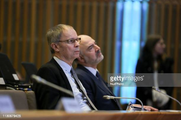 Economics Nobel Prize laureate Jean Tirole and European Commissioner for Economic and Financial Affairs Pierre Moscovici take part in a seminar on...