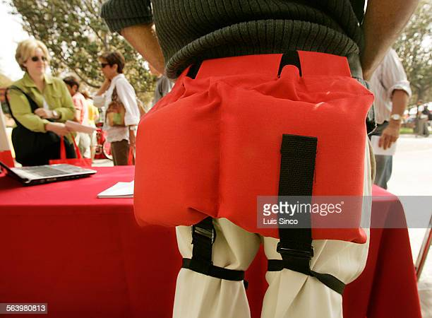 USC economics student Kaveh Motamed models Cushiwear a padded belt that offers protection from hip and pelvic injuries due to falls by the disabled...