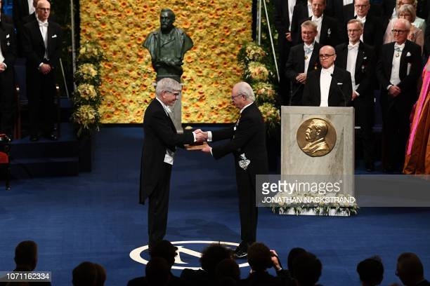 US economist and colaureate of the 2018 Nobel Prize in Economic Sciences Paul Romer receives his Nobel Prize from King Carl XVI Gustaf of Sweden...