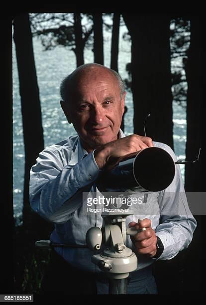 Economist Milton Friedman with Telescope