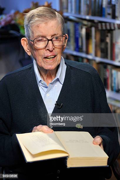 Economist Thomas Worsley holds a classic text on economics by John Maynard Keynes during an interview at his home in Alexandria Virginia US on Monday...
