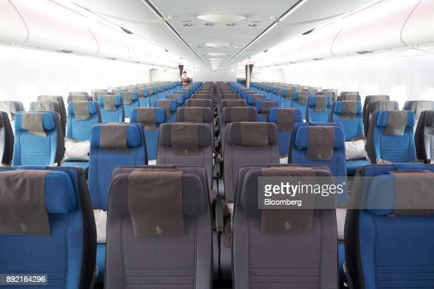 Economy class seats of a Singapore Airlines Ltd Airbus SE A380 aircraft with refitted cabins are seen during a media tour at Changi Airport in...
