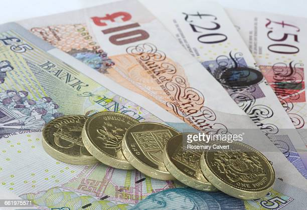 economy, finance, pension and savings. - twenty pound note stock photos and pictures