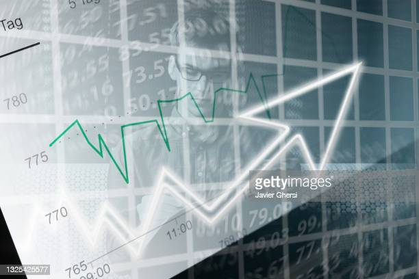 economy graph: rising arrow and executive man. - economist stock pictures, royalty-free photos & images