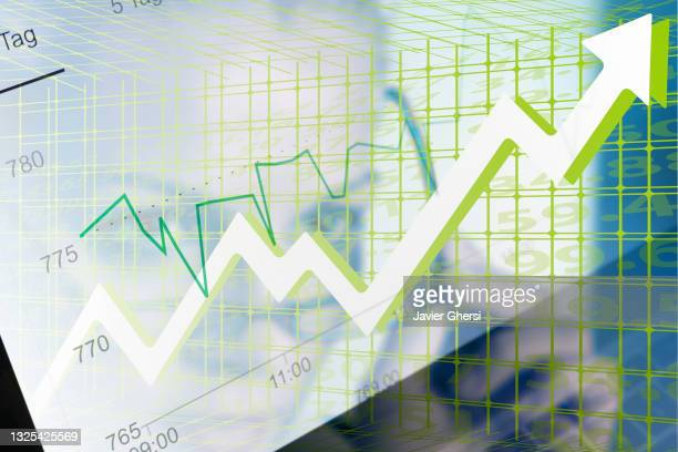 economy graph: rising arrow and executive woman. - moving up stock pictures, royalty-free photos & images