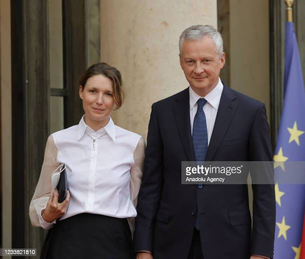 Economy minister Bruno Le Maire and his wife Pauline Doussau de Bazignan arrive for a state dinner with the French President Emmanuel Macron and the...