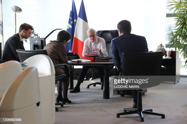 Economy minister Bruno Le Maire speaks with Advisor Charles Sitzewstuhl French Treasury managing director Odile RenaudBasso and cabinet deputy...