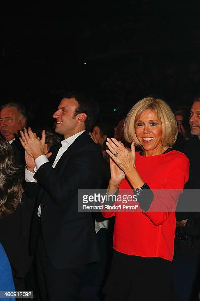 Economy Minister Emmanuel Macron and his wife Brigitte Trogneux attend the Laurent Gerra Show at Palais des Sports on December 27 2014 in Paris France