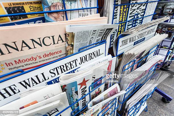 economy newspapers on a newsstand - news stand stock pictures, royalty-free photos & images