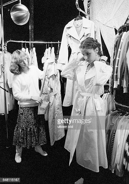 economy retail trade customer and salesgirl in a fashion boutique aged 20 to 30 years
