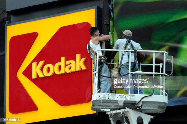 workers at the KODAK billboard at Times Square