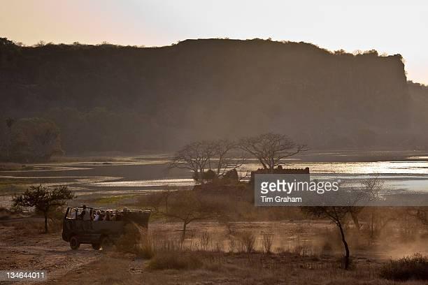 Ecotourists by Padam Lake and Jogi Mahal hunting lodge in Ranthambhore National Park Rajasthan Northern India
