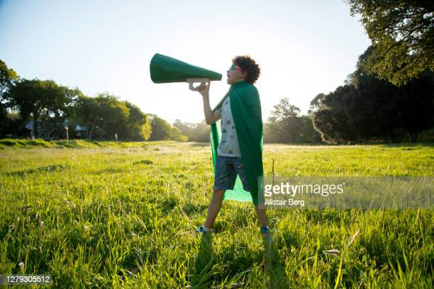 eco-warrior shouting into a megaphone - revolution stock pictures, royalty-free photos & images