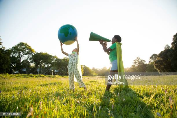 eco-warriors protesting with a megaphone - campaigner stock pictures, royalty-free photos & images