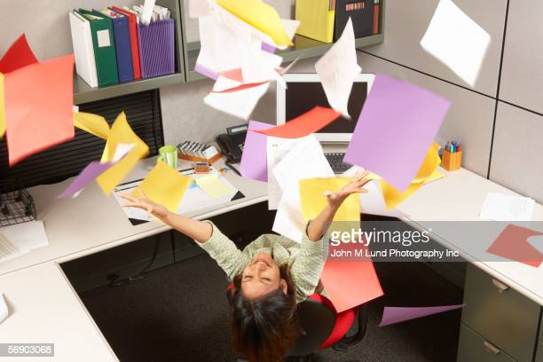 ecstatic businesswoman throwing office papers - quitting a job stock pictures, royalty-free photos & images