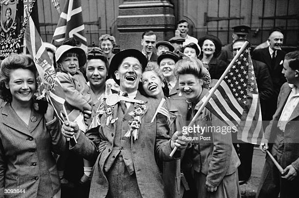 Ecstatic crowds celebrating VE Day in London's Piccadilly at the end of World War II Original Publication Picture Post 1991 This Was VE Day in London...
